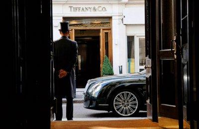 Door man waiting for Bentley